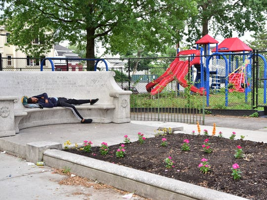 A man passed out on a bench in Paterson's Barbour Park.