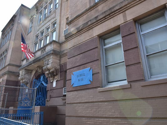 Board member says Paterson should stop using aging School 11