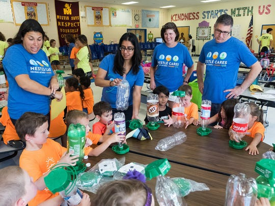 Nestle employees volunteer during Nestle Cares at Milltown Elementary School on Aug. 3 in Bridgewater.