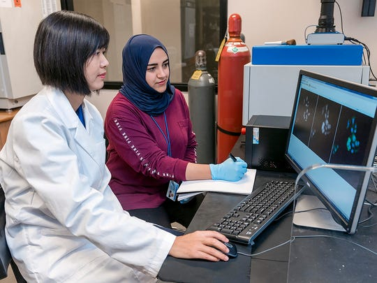 Lead researcher Iris Gao, left, and graduate student