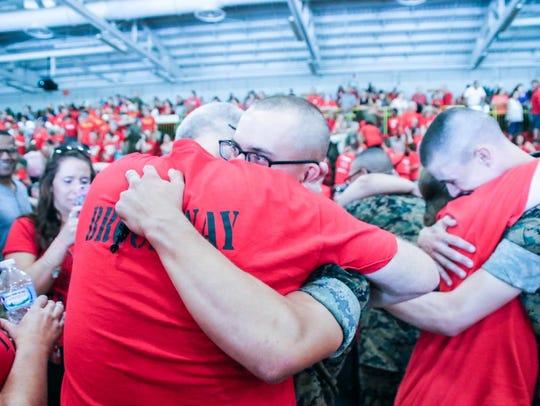 Marine PFC Lukas Brockway hugs his father on family