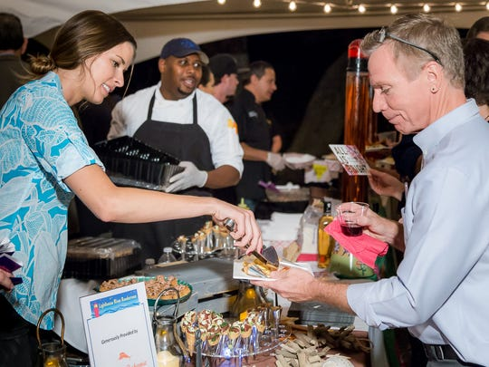 """""""Rendezvous at the Light""""  guests in 2016 enjoy hors d'oeuvres provided by area restaurants, a delicious selection of beer and wine and live music and entertainment."""
