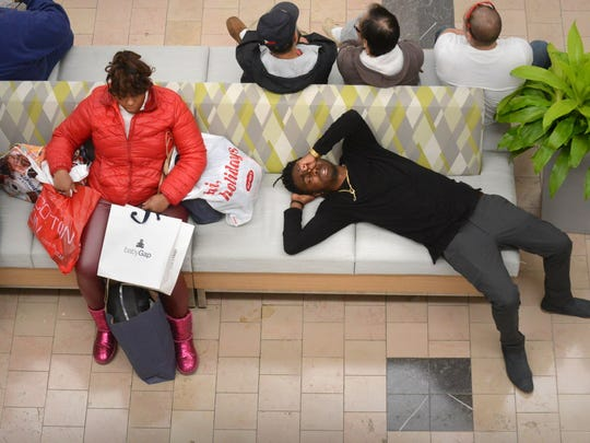 One shopper taking a break from shopping during the Black Friday sales.