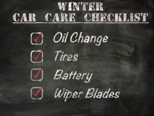 winter car care checklist on blackboard
