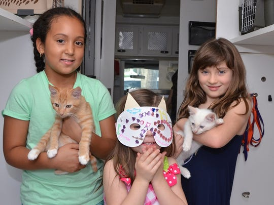 The Humane Society of the Treasure Coast' version of 'Cats:' from left are Sierra McKinney, Carlin Kreps and Sophia Srb.
