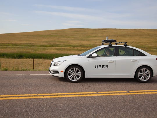 An Uber mapping car stock photo