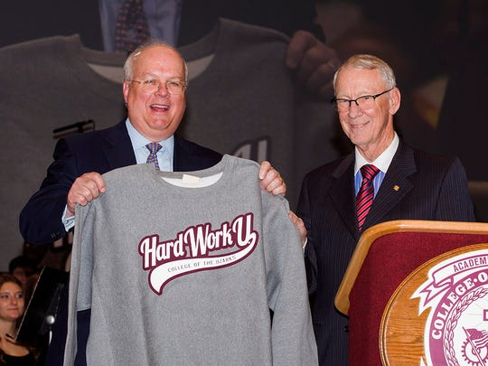 Karl Rove, former presidential senior adviser, spoke Wednesday at College of the Ozarks convocation. He was presented a sweatshirt by college president Jerry Davis.
