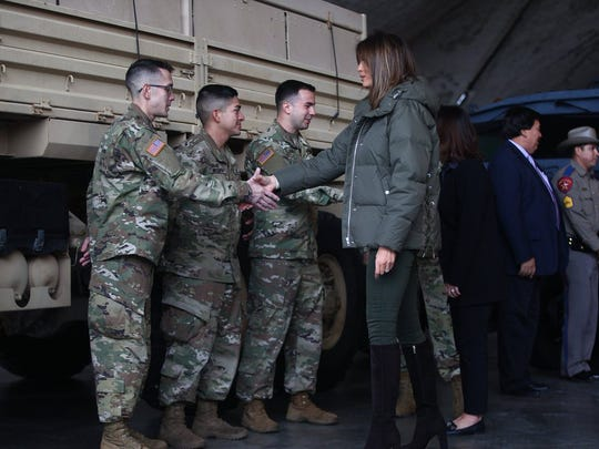 First lady Melania Trump shakes hands with military personnel Wednesday, Dec. 6, 2017, at the Corpus Christi International Airport.