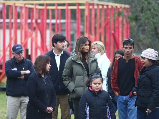First lady Melania Trump (center) and Texas first lady Cecilia Abbott speak with members of the Zamorano family, whose home was damaged by Hurricane Harvey, on Wednesday, Dec. 6, 2017, in Rockport.