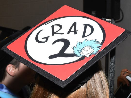 An MTSU graduate's sense of humor shines through atop her mortarboard. University President Sidney McPhee applauded the Univerity of Tennessee's recent announcement to launch a program to make college more affordable for students, but doesn't think it will have a negative impact on enrollment at the Murfreesboro campus.