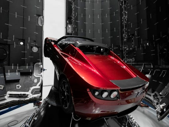 SpaceX CEO Elon Musk says this midnight cherry Tesla Roadster will launch atop the debut flight of the Falcon Heavy rocket, targeted in January from Kennedy Space Center.