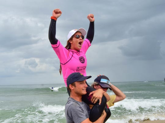 Caroline Marks celebrates after capturing the Ron Jon Florida Pro presented by Sunshine State Florida Lager surf contest at Sebastian Inlet in January 2018.