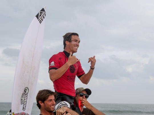 New Smyrna Beach's Evan Geiselman is carried off the