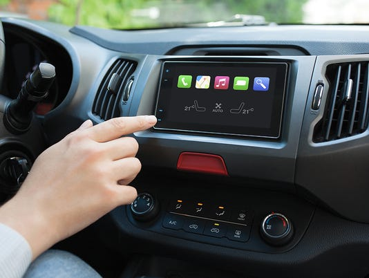 Man hand touching to screen multimedia system with Auto Play