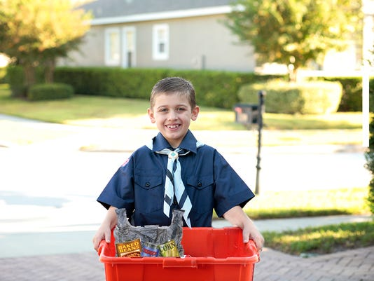 Young Boy Scout with Recycling