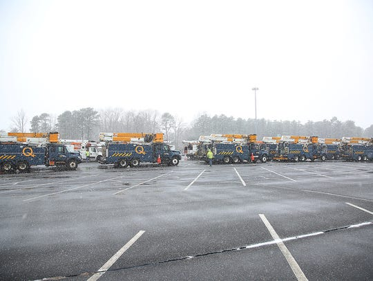 Utility trucks from Hydro Quebec line up at the JCP&L