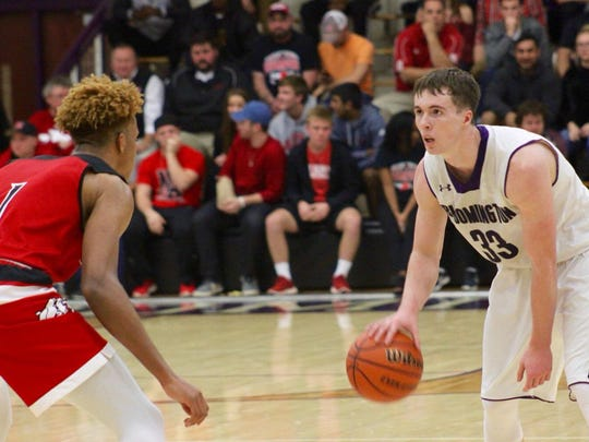 Chance Coyle (right) is defended by Romeo Langford during a game between Bloomington South and New Albany. Coyle will be a second-generation USI player next year.