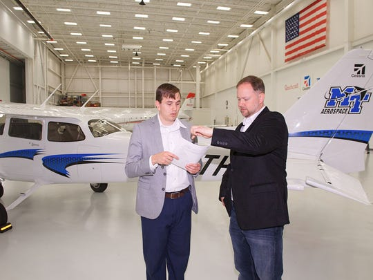 Michael Smith, left, Textron Aviation delivery coordinator, and Nick Lenczycki, MTSU flight operations program manager, discuss MTSU's use of the Cessna Skyhawk 172 April 12 at Textron Aviation headquarters at Dwight D. Eisenhower National Airport in Wichita, Kan.