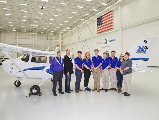 MTSU aerospace students and administrators stand next