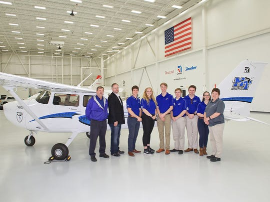 MTSU aerospace students and administrators stand next to the 2018 Cessna Skyhawk 172 delivered to them April 12 in Wichita, Kan. The plane is part of the Textron Aviation Top Hawk program, which awarded five altogether to U.S. universities.