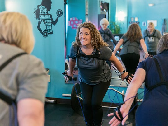 Heather Dunsford, instructor of the OsteoUp class, a type of vertical pilates, encourages her students at the FLOW Aquatic Wellness center in Smyrna.