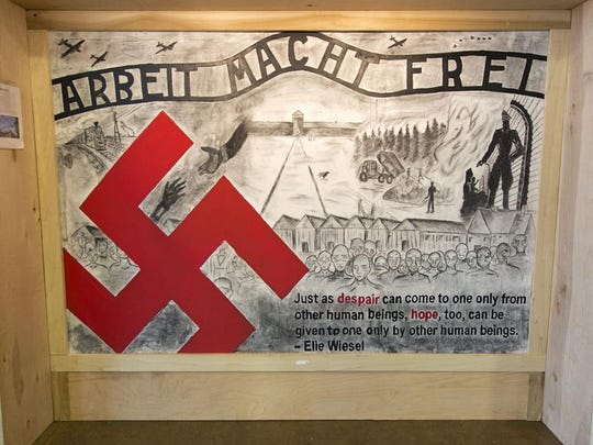 Murals of the Holocaust sit on display at the National Corvette Museum in Bowling Green recently. The murals were created by students who participated in a gifted program at Western Kentucky University recently. The murals will be on display May 18 and May 20 at Henderson's Presbyterian Church.