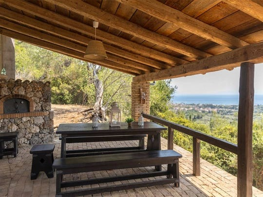 You can dine outdoors at this Corfu island property.