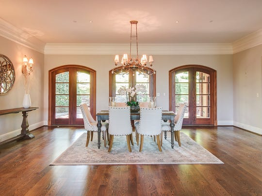 The dining room at 2060 Hillsboro Road. The property is on the market for $6 million.