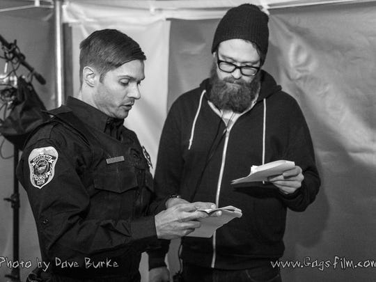 "Actor Evan Gamble, left, and director Adam Krause consult on the set of ""Gags."""