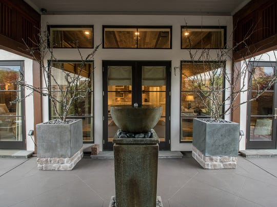 The home's entrance is artistically designed to please.
