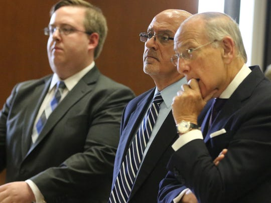 Former Bloomfield Councilman, Elias Chalet, shown between his attorneys, at Superior Court in Newark,  was  sentenced to five years in jail. Thursday, July 12, 2018.