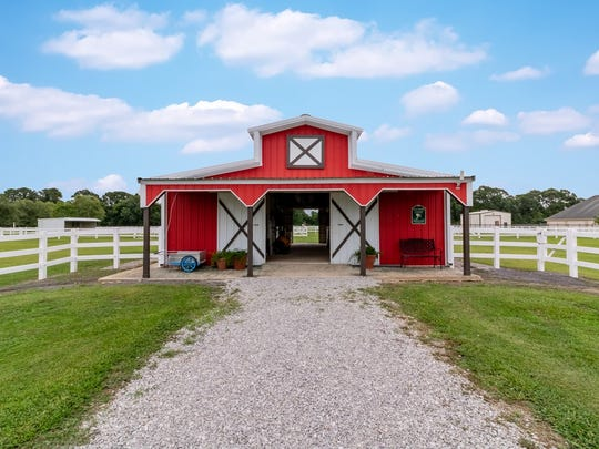 There is a barn for horses that is well maintained