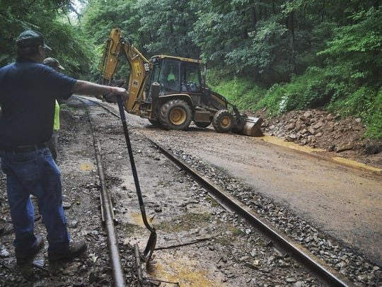 York County Parks employees work to remove a mudslide