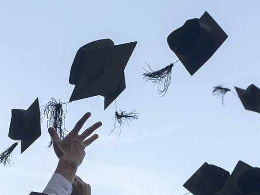 Mortarboards fly