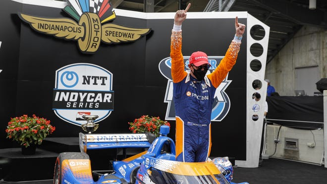 Race driver Scott Dixon, of New Zealand, celebrates after winning the IndyCar race at Indianapolis Motor Speedway in Indianapolis on Saturday.