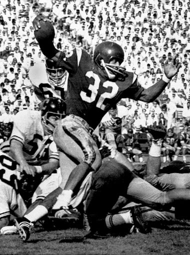 O.J. Simpson tried to break a California tackle as he picked up five yards in Los Angeles Memorial Coliseum on November 9, 1968.