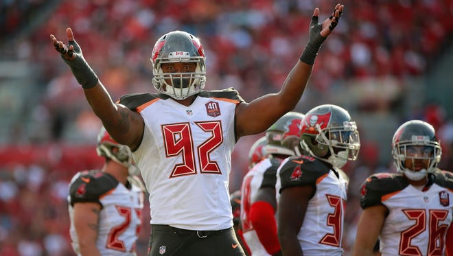 Tampa Bay defensive end William Gholston (92) gets the Buccaneers crowd pumped up against the Dallas Cowboys in November.