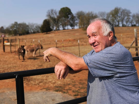 Lynn Paxton stands beside a pasture on his 8-acre farm Monday, Nov. 7, 2016, in Strawberry Plains. Paxton and other residents are upset about Nyrstar Tennessee Mines' recent efforts to test for minerals on their property.
