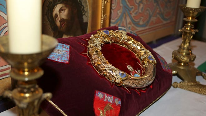 A crown of thorns which was believed to have been worn by Jesus Christ and which was bought by King Louis IX in 1239 is presented at Notre Dame Cathedral in Paris, Friday March 21, 2014. To mark the 800th anniversary of Louis IX's christening, the crown of thorns will be displayed outside Notre Dame, at the Collegiate Church of Poissy, where King Louis IX was christened.