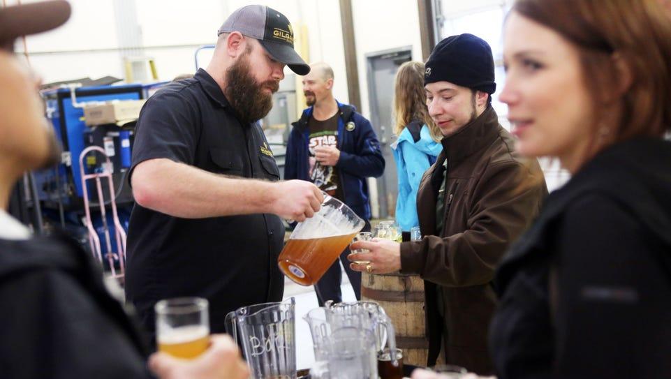 Nick Radtke pours beer samples as part of Zwickelmania