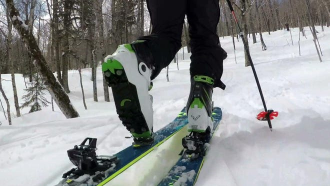 """In this Saturday, April 21, 2018, photo, provided by Andrew Drummond, Drew Zimber """"skins"""" uphill using backcountry skis with climbing skins attached to the base, on Crescent Ridge in the Randolph Community Forest in Randolph, New Hampshire."""