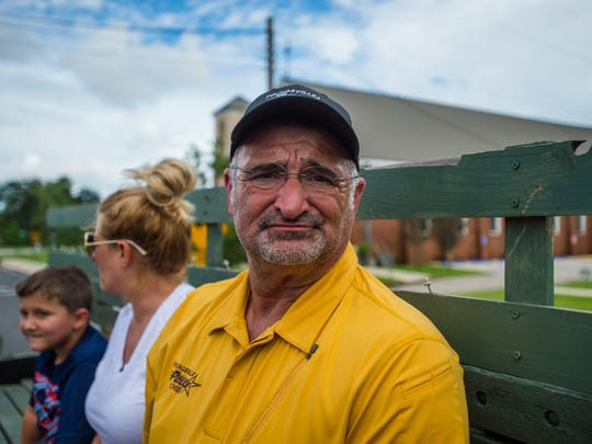 Youngsville Police Chief Rickey Boudreaux takes a short break from assisting flood victims to view the damage to his own home in Highland Subdivision last summer.