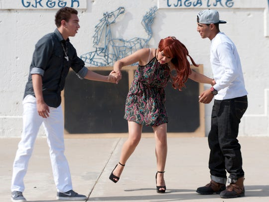 """Tulare Western students RAymond Gomez, left, Ariel Rodriguez and Corey Juarez rehearse in their outdoor Greek Theatre for their production of """"Midsummer Jersey,"""" an adaptation of """"A Midsummer Night's Dream"""" that mixes the original story with """"Jersey Shore"""" on Wednesday, April 22, 2015."""