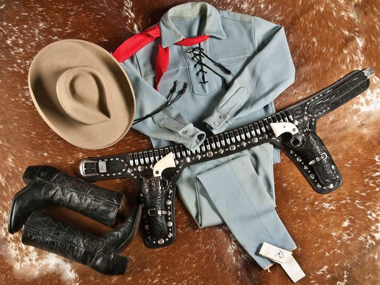 """This photo provided by A & S Auction Company of Waco, Texas shows the outfit Lone Ranger actor Clayton Moore wore when he made appearances as the character after retiring from television. A & S Auction Co. will offer up the items for auction on Saturday, July 12, 2014. Moore, who died in 1999, played the masked lawman on the ABC television series """"The Lone Ranger"""" from 1949 to 1957. (AP Photo/A & S Auction Co.)"""