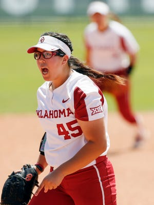 FILE - In this Friday, May 10, 2019, file photo, Oklahoma pitcher Giselle Juarez screams after getting a strikeout to end the top of the third inning against Texas Tech during a Big 12 softball tournament game in Oklahoma City. Oklahoma and Oklahoma State have both qualified for the Women's College World Series for the first time since 2011. It should be an extra special week for the event to have two schools located within 90 minutes of USA Hall of Fame Stadium. (Nate Billings/The Oklahoman via AP, File)