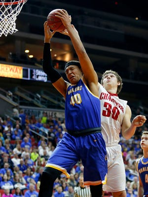 Cordell Pemsl of Wahlert and TJ Hockenson of Chariton fight for a rebound in the boys 3A semifinal game Thursday, March 10, 2016.