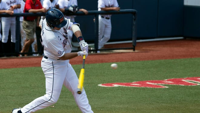 Ole Miss third baseman Colby Bortles swings at a pitch in Saturday's game against Auburn. Ole Miss won 7-4, its fourth consecutive victory.