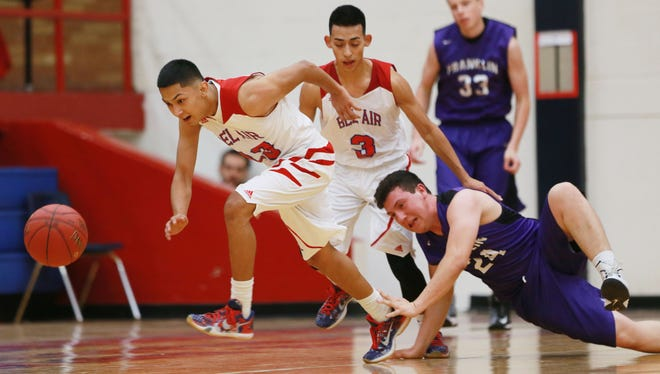 Bel Air's Isaiah Acosta, left, sprints after the basketball after he and teammate Sergio Enriquez knocked it away from Franklin's Jose Jurado during second-quarter action Monday night at Bel Air High School.