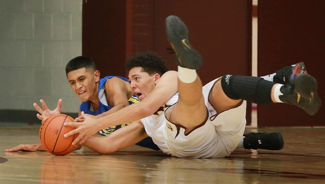Eastwood's Daniel Vargas, left, and Andress' Kendall Barday fight for control of the ball during the second quarter Tuesday at Andress High School.