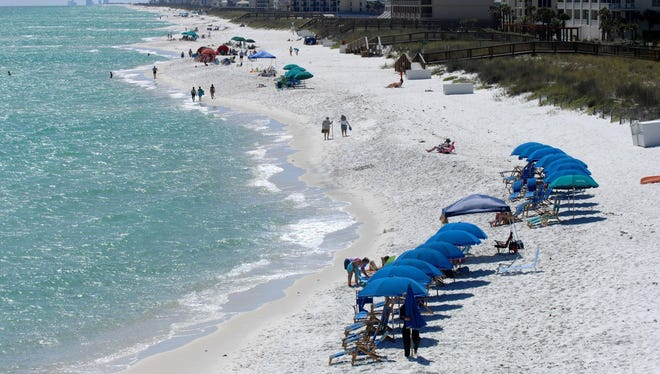 Santa Rosa County Commissioners want to spend nearly $500,000 to build three picnic pavilions at Navarre Beach as part of a walkover complex.